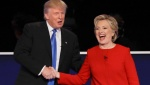 Clinton, Trump Battle Over Taxes, Race, Terror